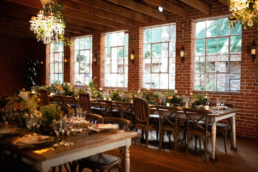 Rustic dinner party with long farm tables designed by Eddie Zaratsian for the Allison Webb Spring 2019 Bridal Collection