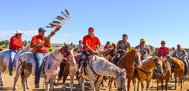 A rally led on horseback by the Standing Rock Sioux Nation and their allies. (Photo: Robert Wilson)