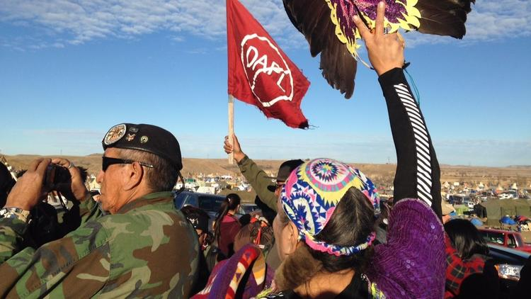 Demonstrators against the Dakota Access oil pipeline hold a ceremony at the main protest camp Nov. 15 near Cannon Ball, North Dakota. (James MacPherson / Associated Press)