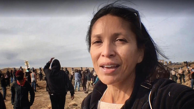 Journalist Jenni Monet reports from an Oct. 27 sweep during a mass demonstration over the Dakota Access pipeline in Morton County, North Dakota. (Photo courtesy of Jenni Monet)