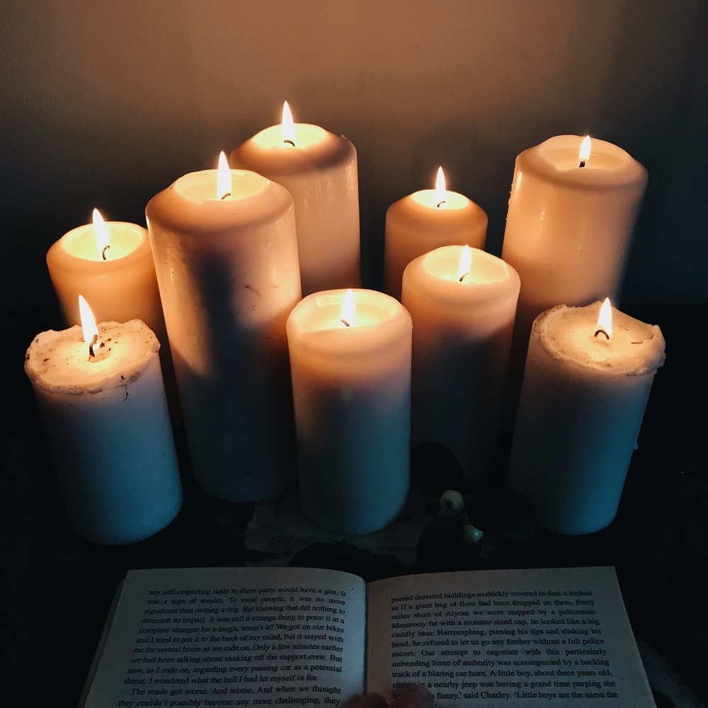 reading a book candlelight