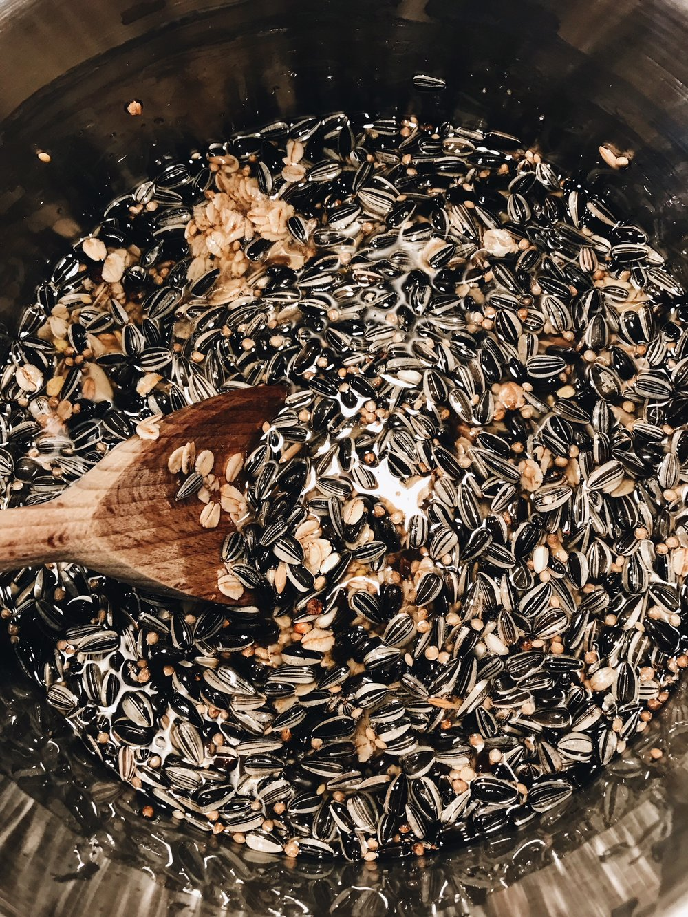 mixing bird seeds and lard