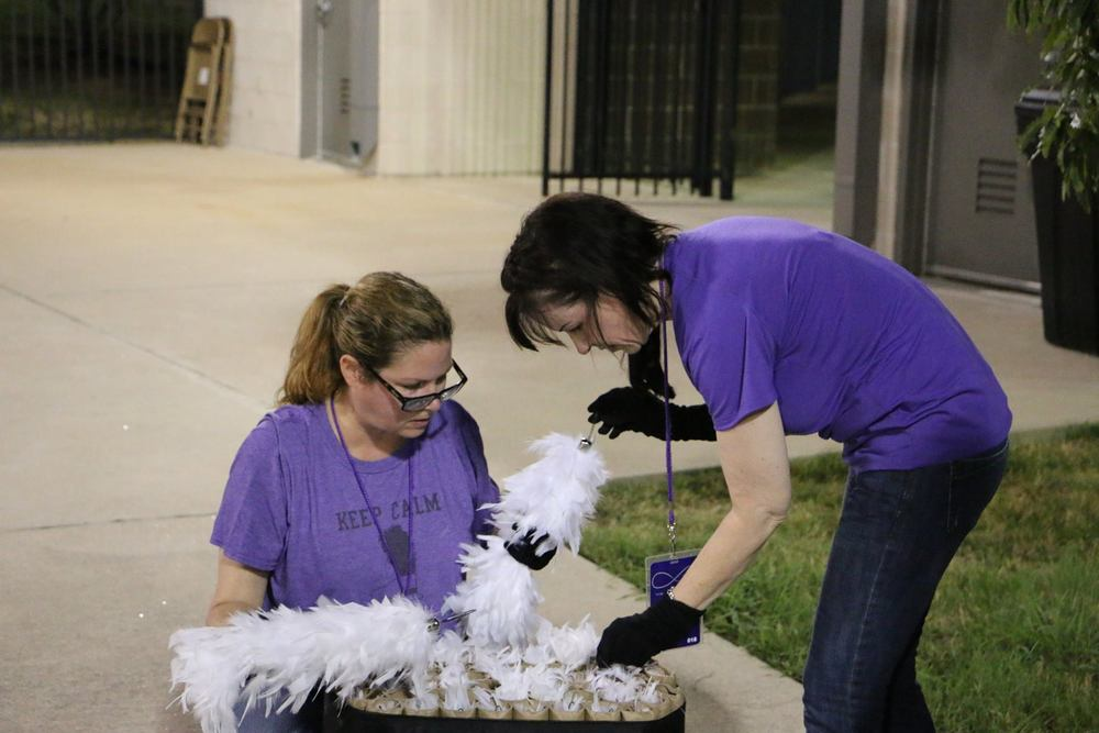 Volunteers with Plumes.jpg