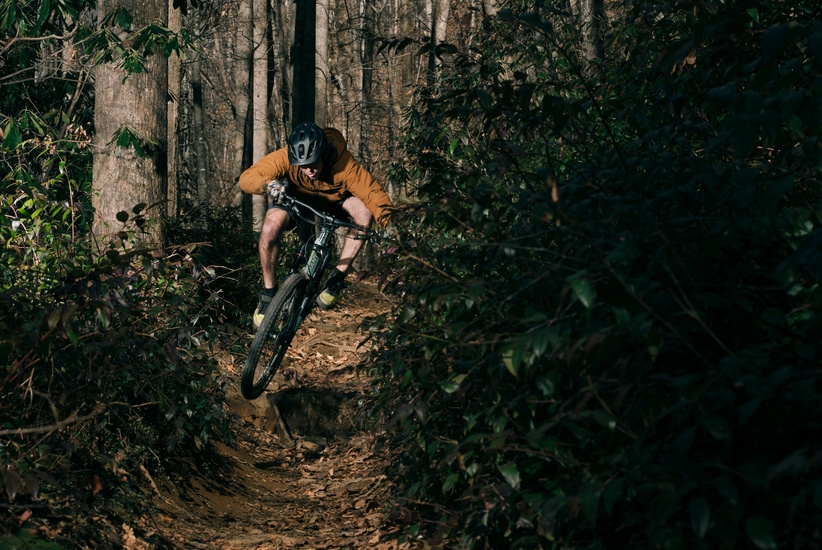 Charging hard through the lush forest...
