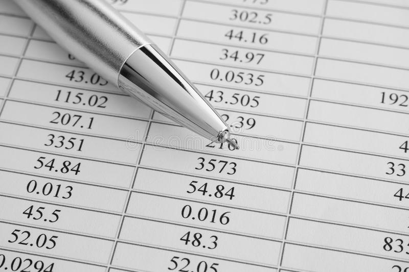 financial-statements-ballpoint-pen-financial-statements-black-white-image-close-up-65137360.jpg