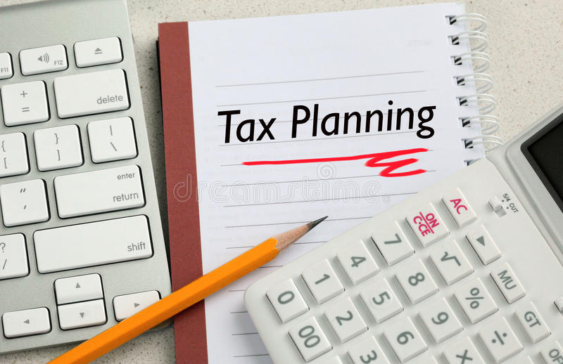 concept-tax-planning-calculator-desk-background-52779493.jpg