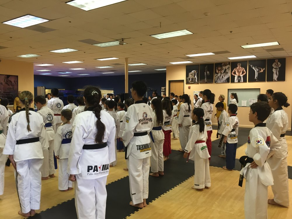 Standing in formation at TaeKwon Kids