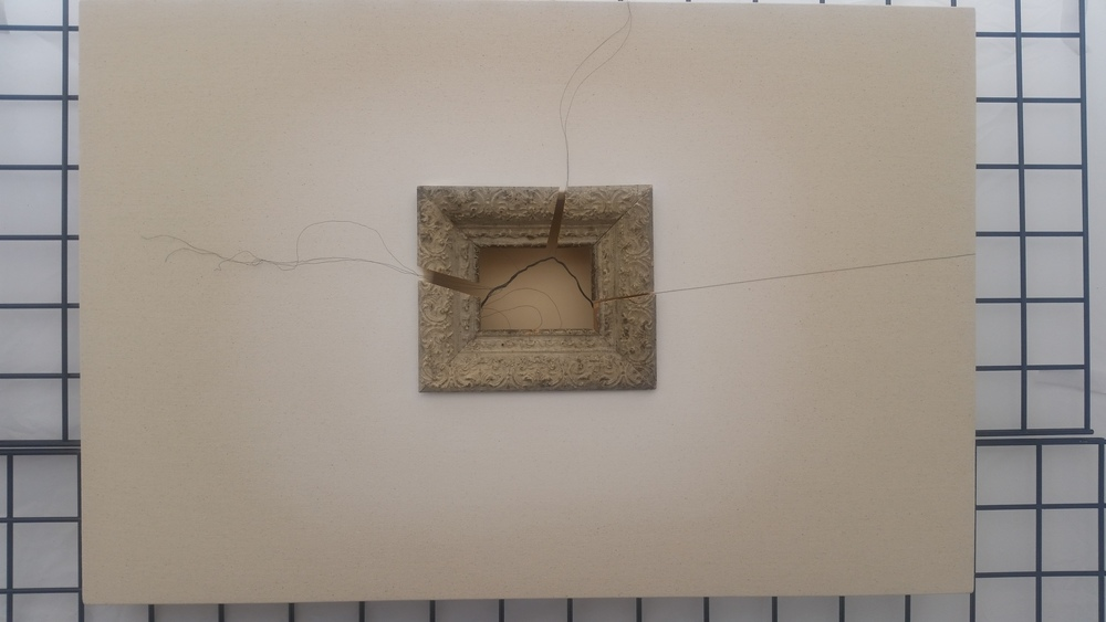 Art by Doris Purchase. This work exposes the unseen, raw elements of a painting (the frame, the wire, the plain canvas)