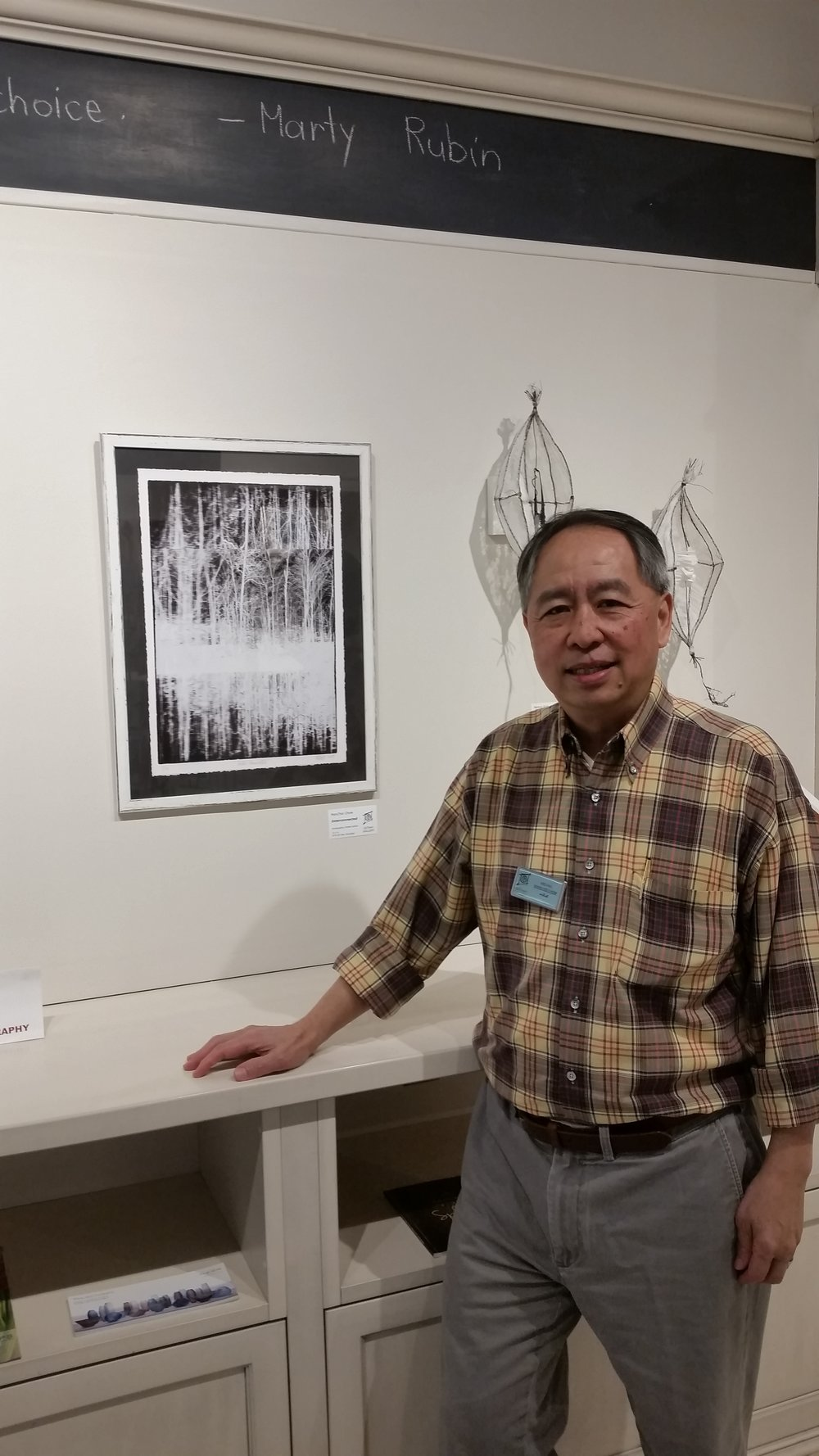 "ManChoi Chow at UpTown Gallery with his work ""Interconnected"""
