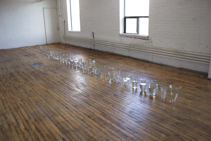 "-ness (II) , glassware and water, 20' x 10"" x 12"", 2018"