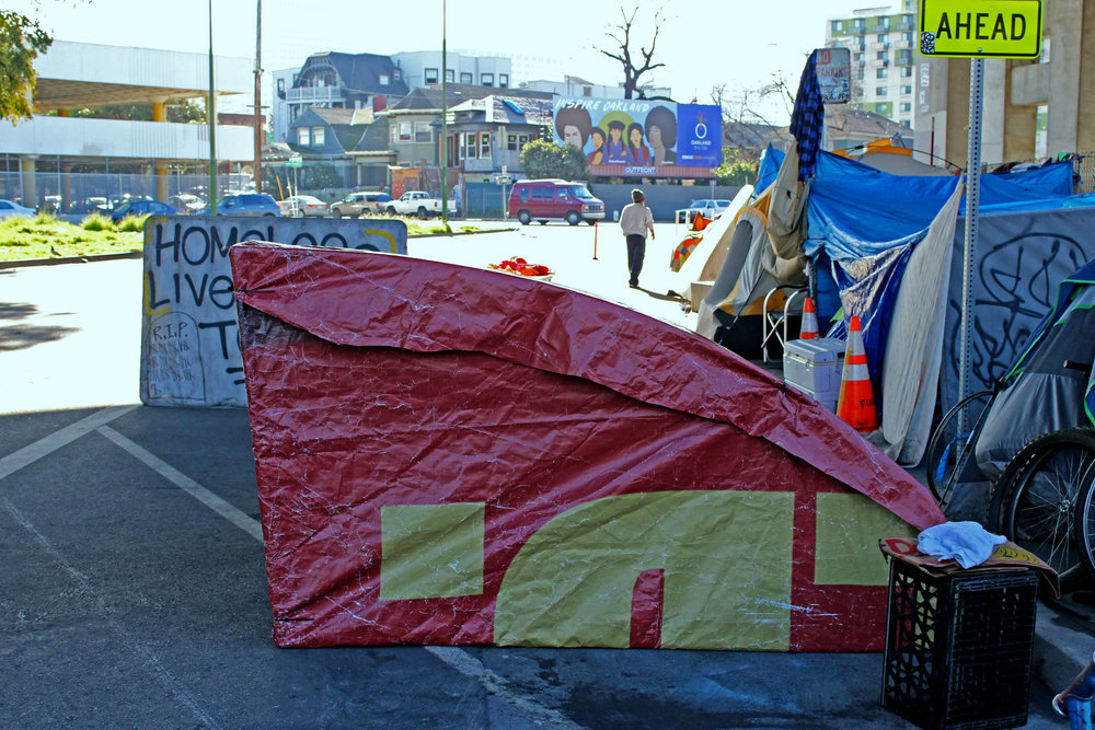"This tent was fashioned from a Budweiser billboard that reads, ""You've just struck cold."""