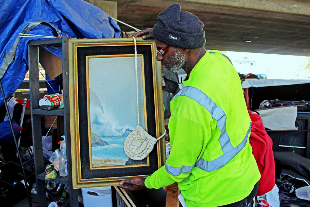 A Northgate resident collects found treasures like this framed painting of the ocean. Before becoming homeless he worked for BART where he was responsible for clearing out homeless encampments.
