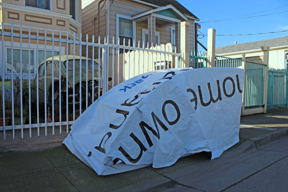 A tent made from a Chase Bank billboard.
