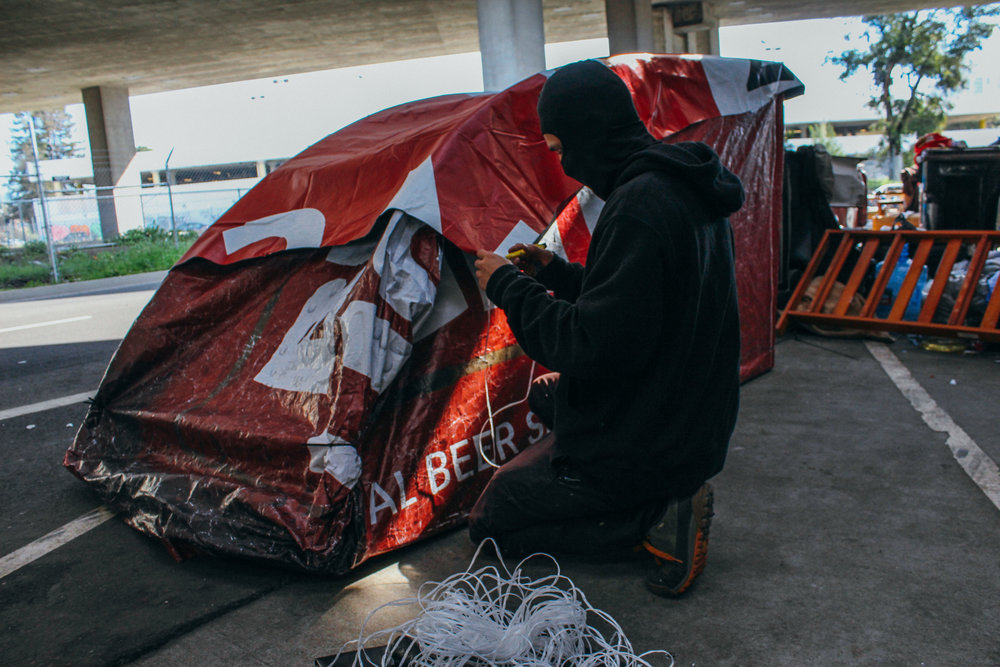 "Article: ""This Graffiti Artist Is Tearing Down Billboards and Turning Them Into Shelters for the Homeless"""