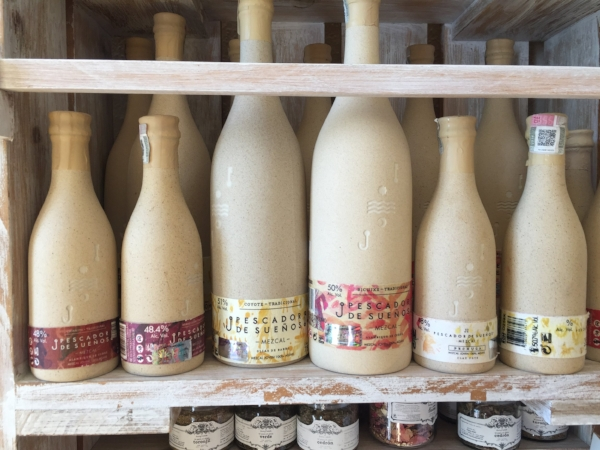 An entire wall of mezcal at a specialty store in Todos, but these bottles stood out. They were made from clay and the mezcal was exceptional as well.