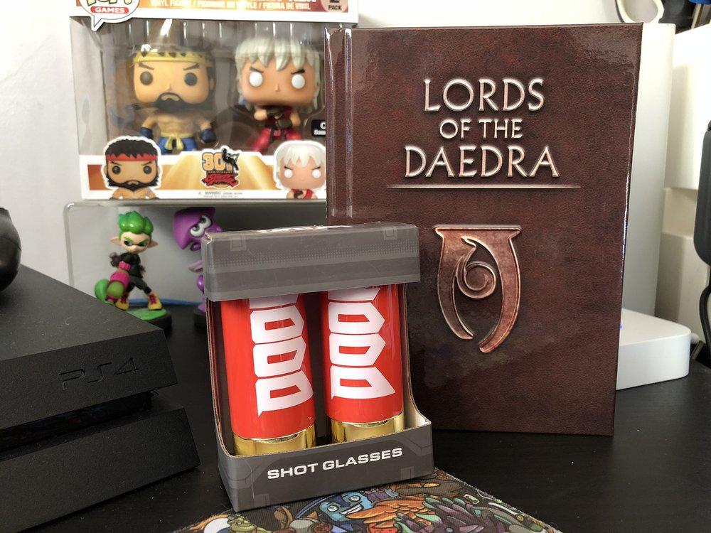 DOOM shotgun shell mini glasses and Skyrim Lords of The Daedra Book.