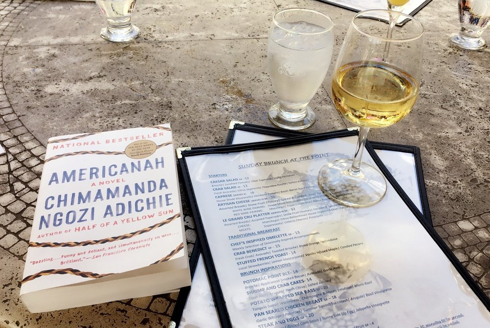 """#1 - Americanah by Chimamanda Ngozi Adichi """"Ifemelu and Obinze are young and in love when they depart military-ruled Nigeria for the West. Beautiful, self-assured Ifemelu heads for America, where despite her academic success, she is forced to grapple with what it means to be black for the first time. Quiet, thoughtful Obinze had hoped to join her, but with post-9/11 America closed to him, he instead plunges into a dangerous, undocumented life in London. Fifteen years later, they reunite in a newly democratic Nigeria, and reignite their passion-for each other and for their homeland."""""""