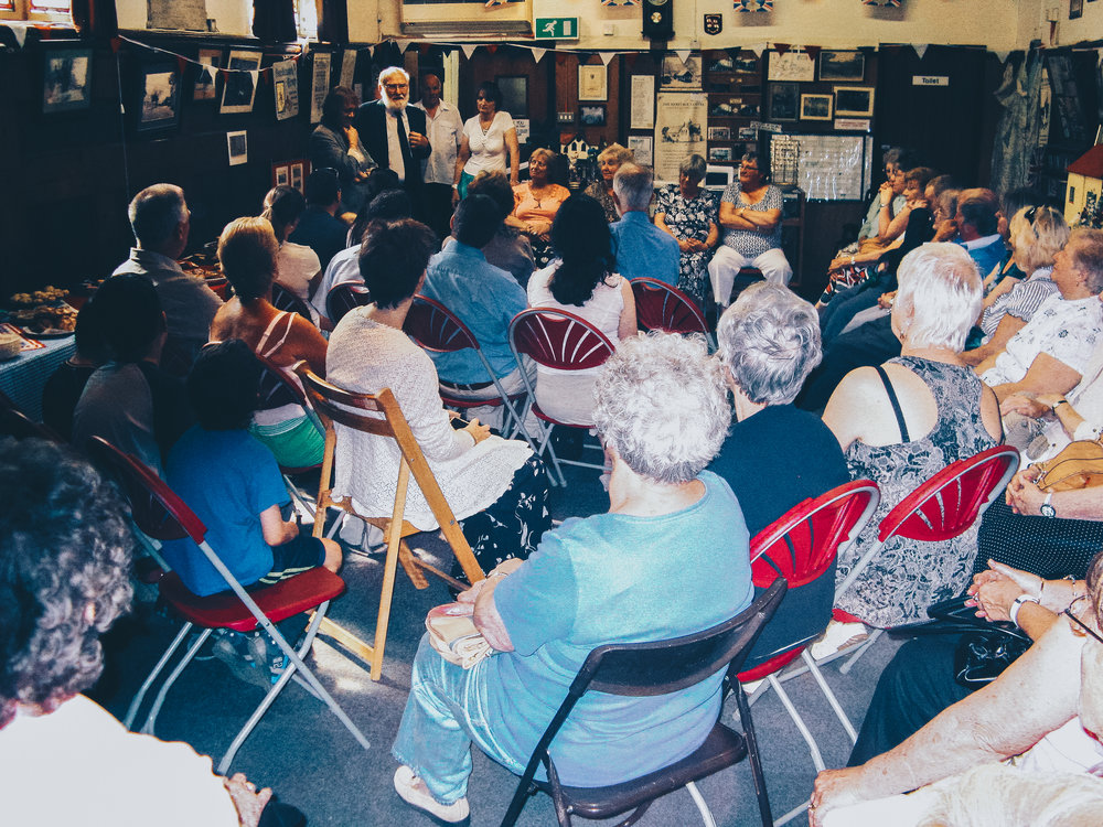 One of the many town halls in which the party organised to debate new policy and new ideas on how to improve the town. We designed the chair layout to be similar to the layout of the United Nations security council. The people chosen were decided by algorithm on how passionate they were about independence.