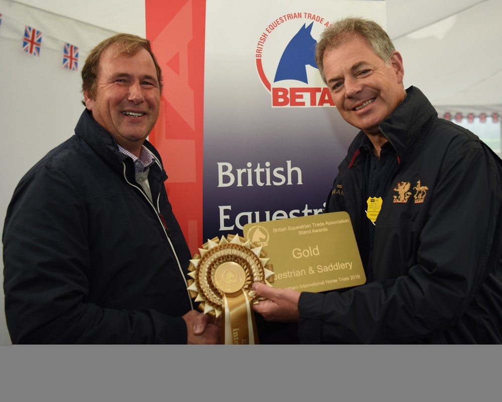 Ayr Equestrian's Kevin Galbraith (left) receives his gold certificate from Bramham Park owner Nick Lane Fox.