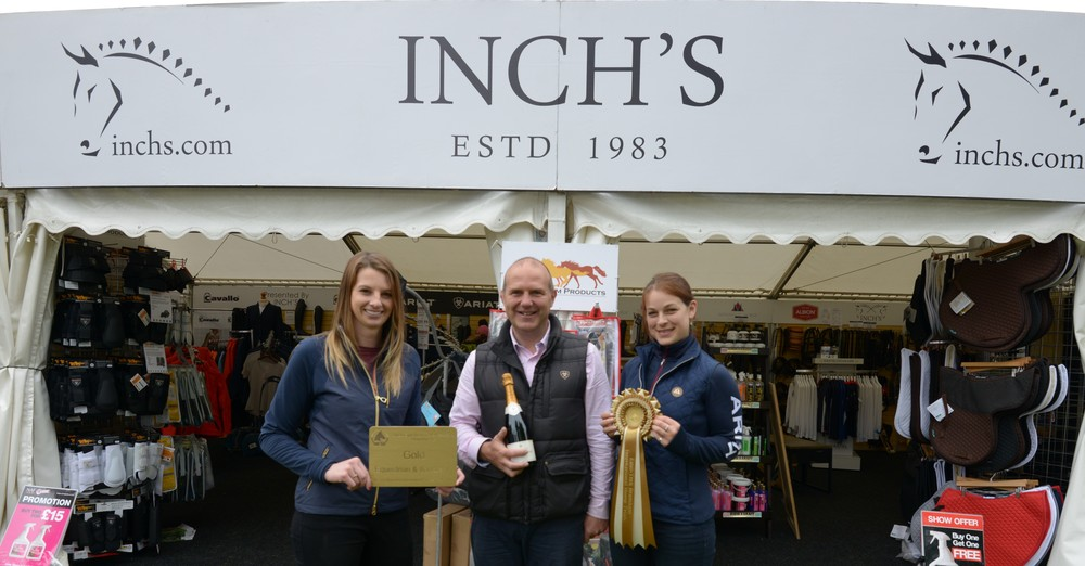 Rachel Swinden, Roy Male and Emma Buck, of Inch's Saddlery, celebrate winning gold.