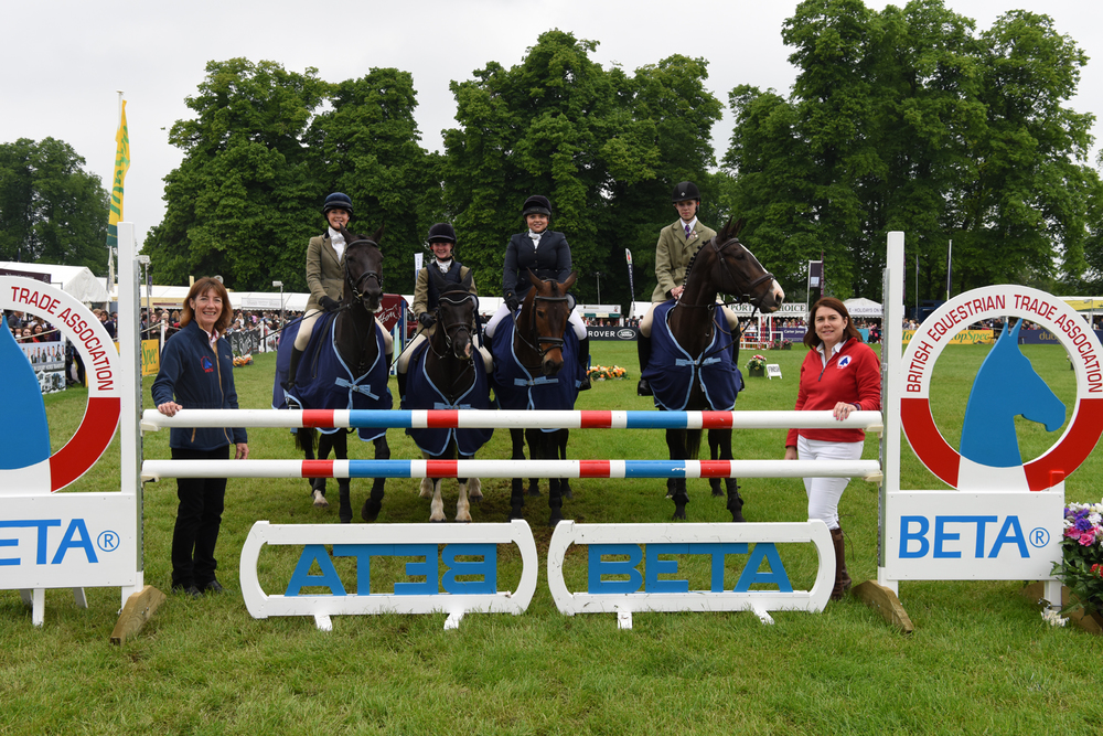 BETA's Claire Williams & Alison Sherwood-Bruce congratulate Bedale & West of Yore members ( Amelia Hattersley, Lucy Hattersley, Robyn Chilton & Jake Clark) on winning the Pony Club Team Show Jumping