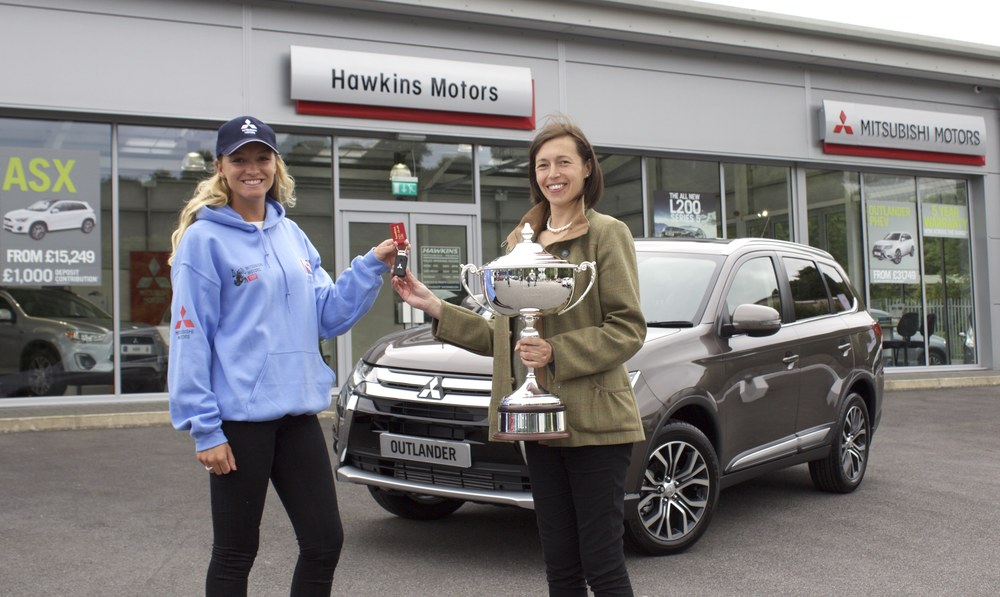 Emily King (left) passes the keys to winner Katie Hancock (right) (Credit: British eventing)