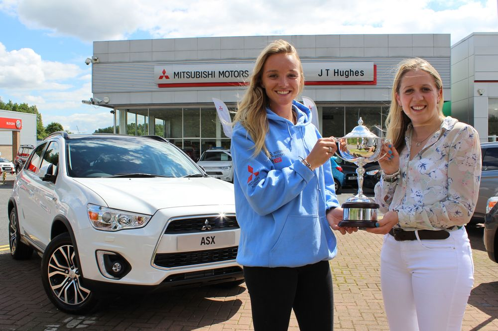 Sophie Walker (right) collects her winning trophy from Emily King (Left) (Credit: British eventing)