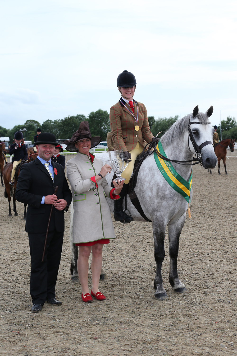 Isabella and Inverin Paddy receiving the Topspec Supreme Pretty Polly Championship award from judges Cindy Henson and Adam Brooke.