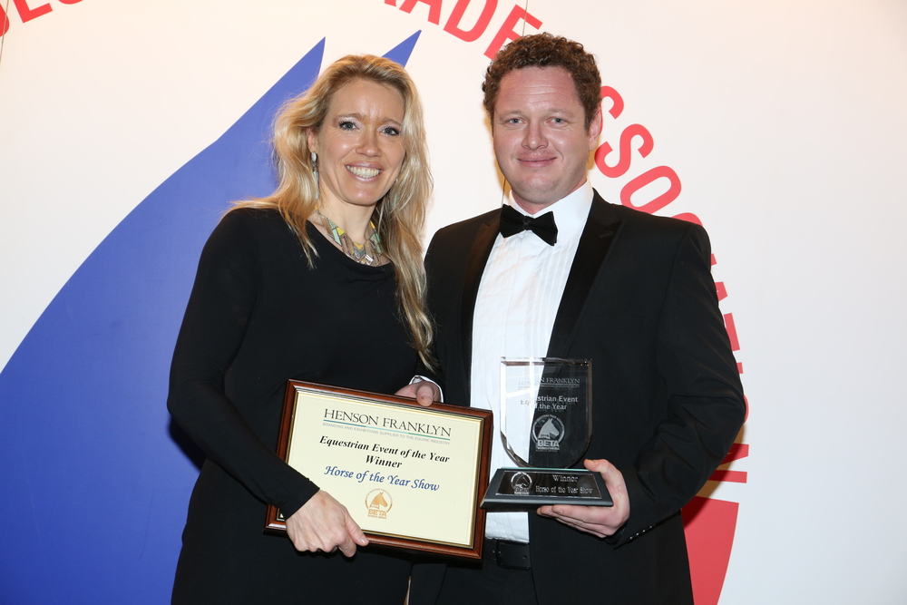 Helena Pettit of the Horse of the Year Show, collecting the winner's trophy last year from Danny Wade of award sponsor Henson Franklyn.