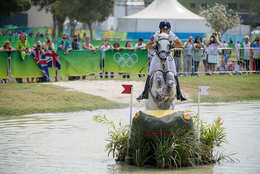 Riding Billy The Biz, Pippa Funnell tackle a fence in the water at Deodoro (Credit:BEF/Jon Stroud Media)