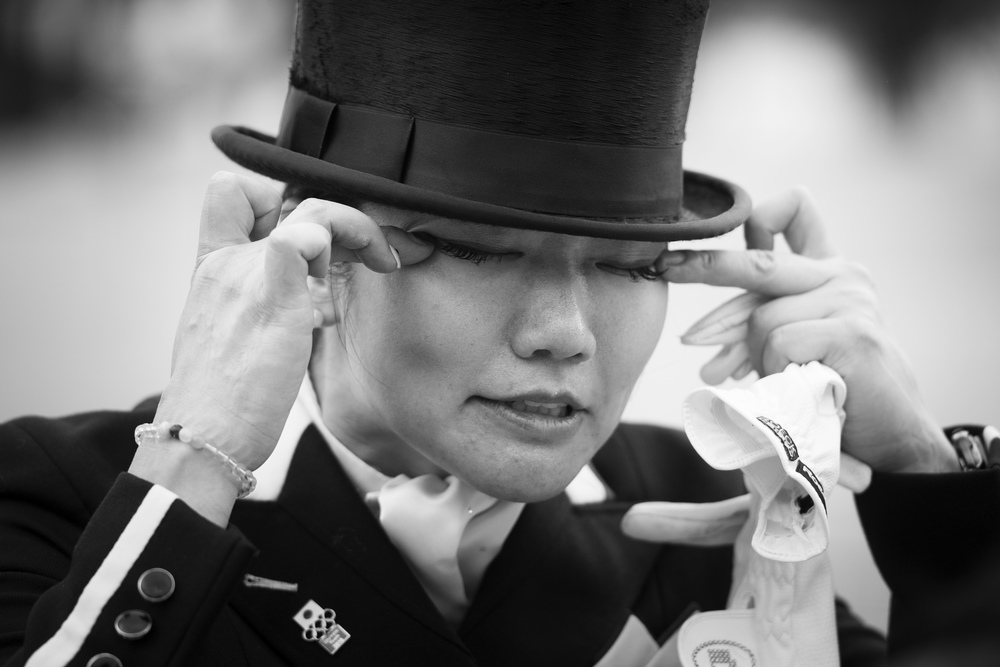 Japan's Akane Kuroki sheds tears of relief and delight after posting a good score with Toots to get the Japanese effort underway at Olympic Dressage in Deodoro Olympic Park in Rio de Janeiro (BRA) today. (Richard Juillart/FEI)