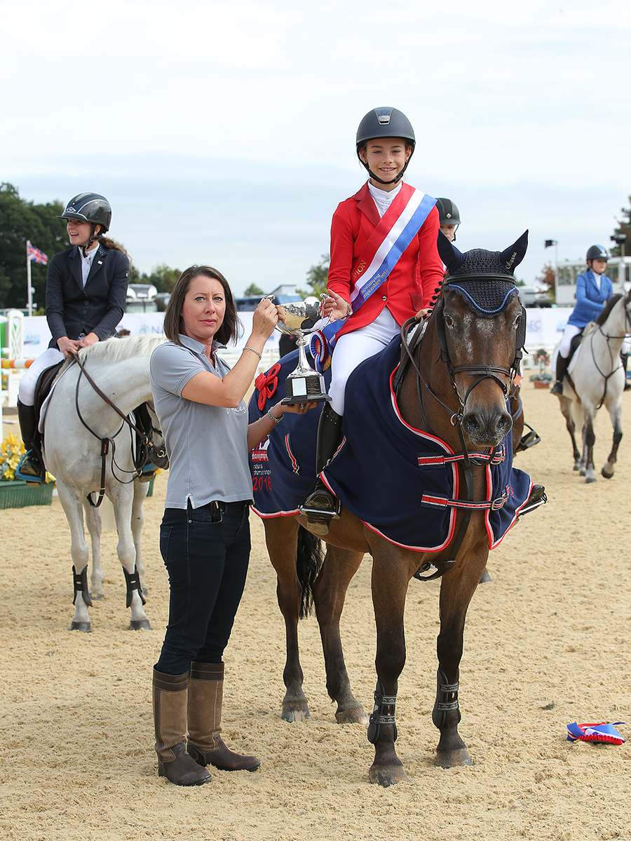 Emilia Michaell awarded the title in the National 138cm Championship Final (Credit: 1st Class Images)