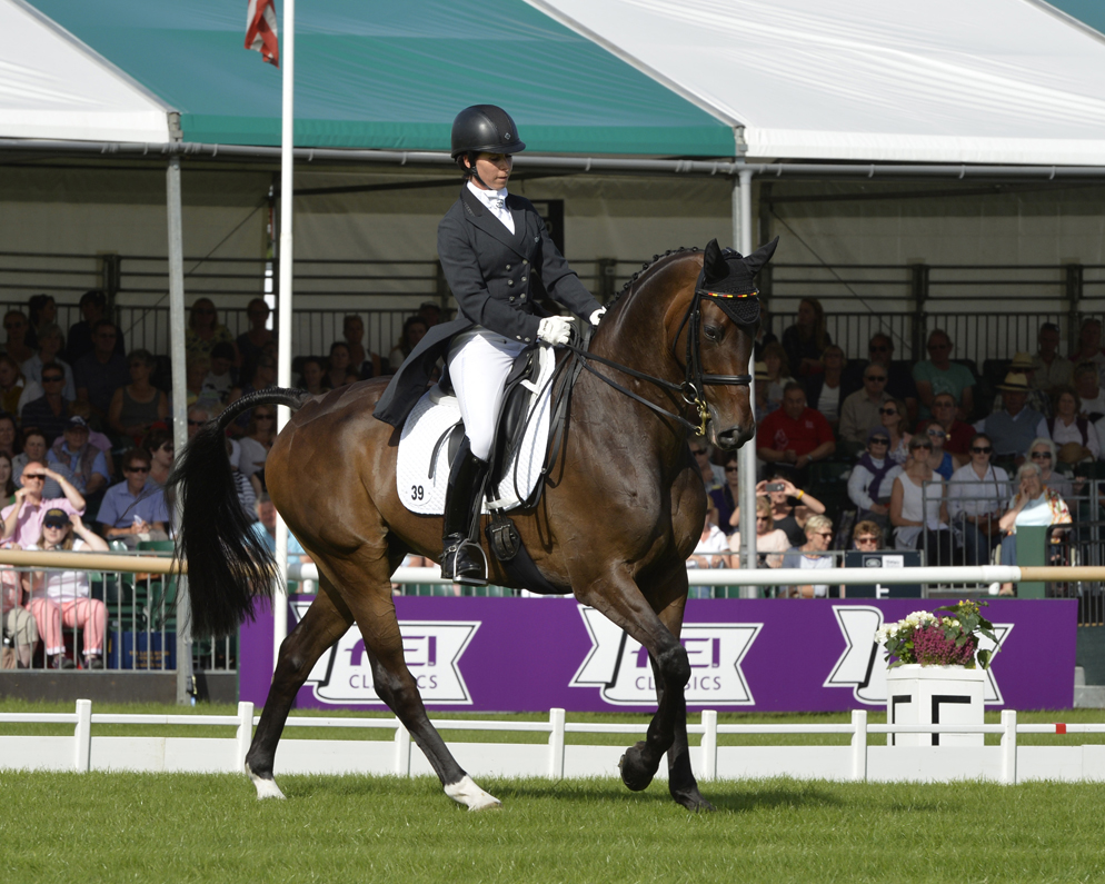 Bettina Hoy (GER) and Designer 10 produce a superb display at the Land Rover Burghley Horse Trials, final leg of the FEI Classics™ 2015/2016, to take a commanding lead after the first day of Dressage (Trevor Meeks/FEI)