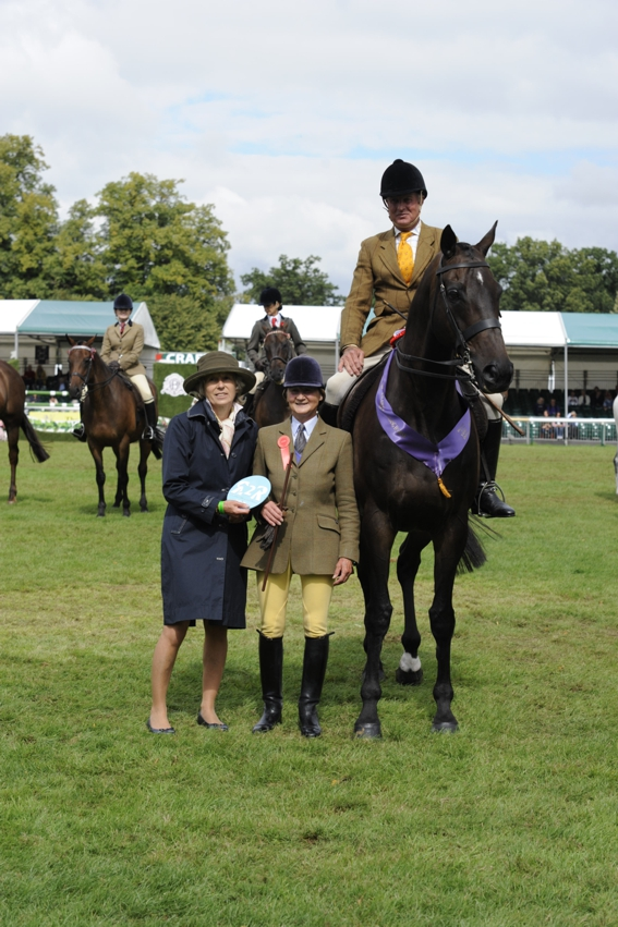 Jack the Giant and Allister Hood receiving their prizes from judges the Honourable Hopper Cavendish and Jane Hubbard (Credit: JPC Images)