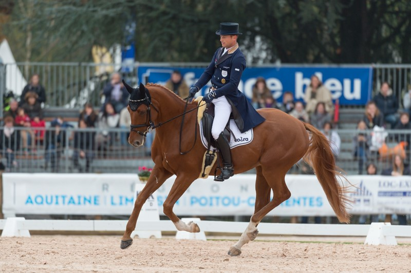 Another first place: Michael Jung (GER) and his 2015 Euorpean champion FischerTakinou lead after Dressage at Les 4 Etoiles de Pau, first leg of the FEI Classics™ 2016/2017. (Credit: Trevor Holt/FEI)