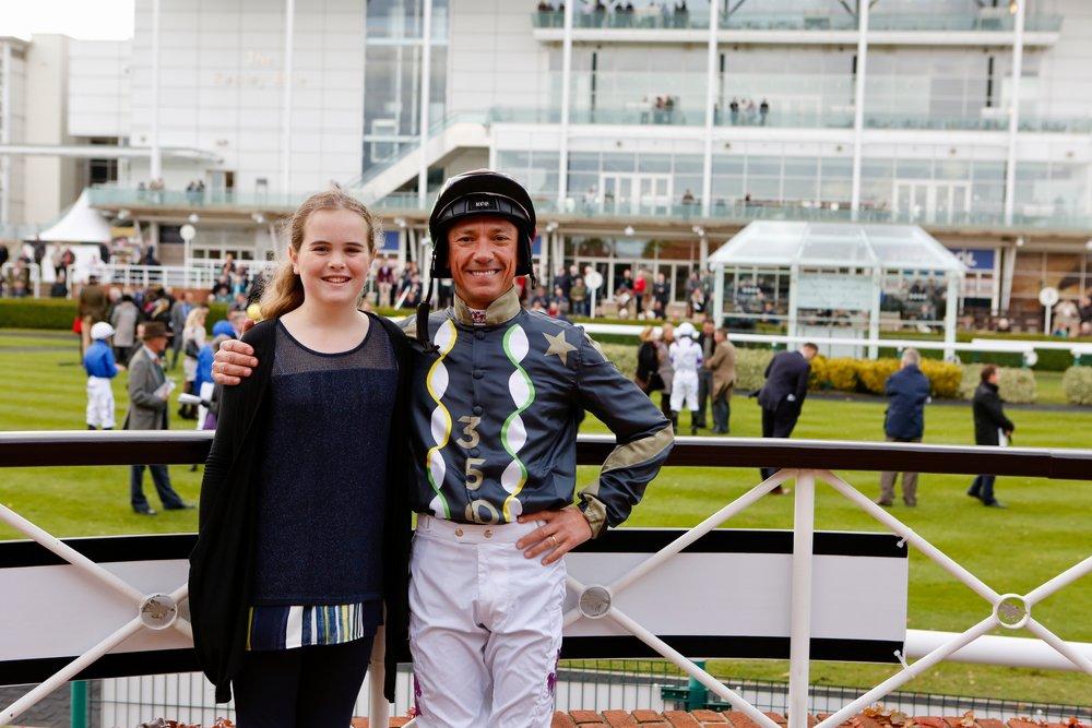 Frankie Dettori wearing the favourite winning jockey silks alongside the designer Naomi Baldock