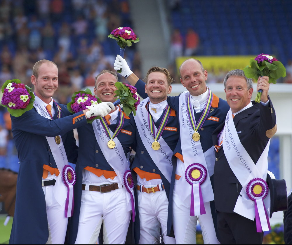 Wim Ernes, Olympic Dressage judge and Dutch team coach, has passed away at the age of 58. He is pictured here (far right) celebrating with (left to right) his gold medal winning team of Diederik van Silfhout, Patrick van der Meer, Edward Gal and Hans Peter Minderhoud at the FEI European Championships 2015 in Aachen (GER). (Credit: Arnd Bronkhorst)