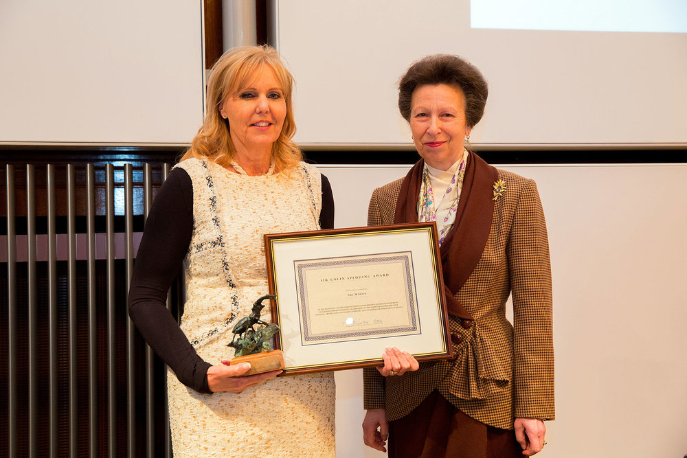 Sue Martin BHSII, pictured here with HRH Princess Anne,  who runs Trent Park Equestrian Centre won the award in 2016.