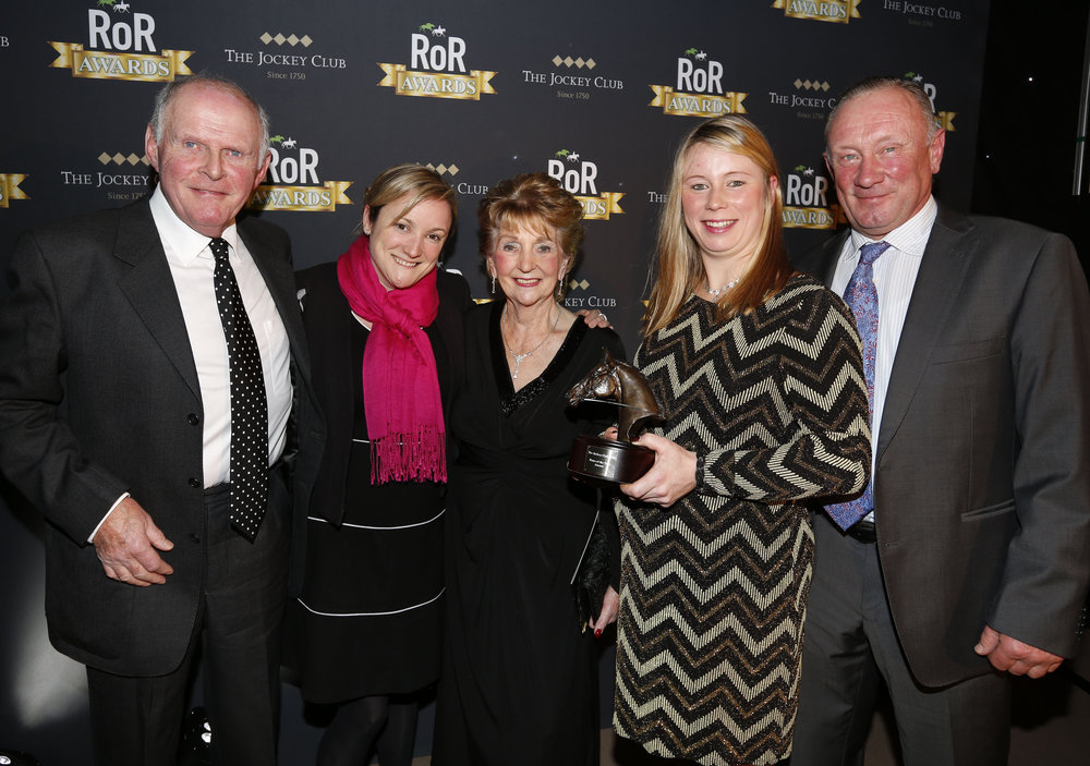 The Jockey Club's Amy Starkey, second left, presents the award for RoR Horse of the Year to the connections of Monet's Garden.