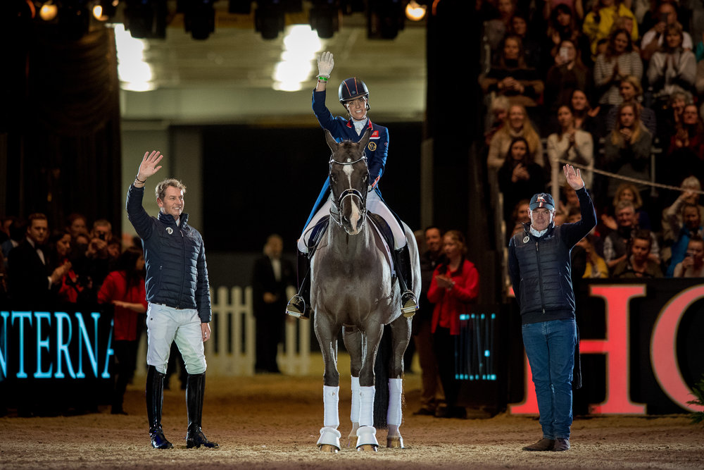 (L-R) Carl Hester, Charlotte Dujardin riding Valegro and Alan Davies on the night Valegro bows out from the world of dressage (Credit: Jon Stroud Media/FEI)
