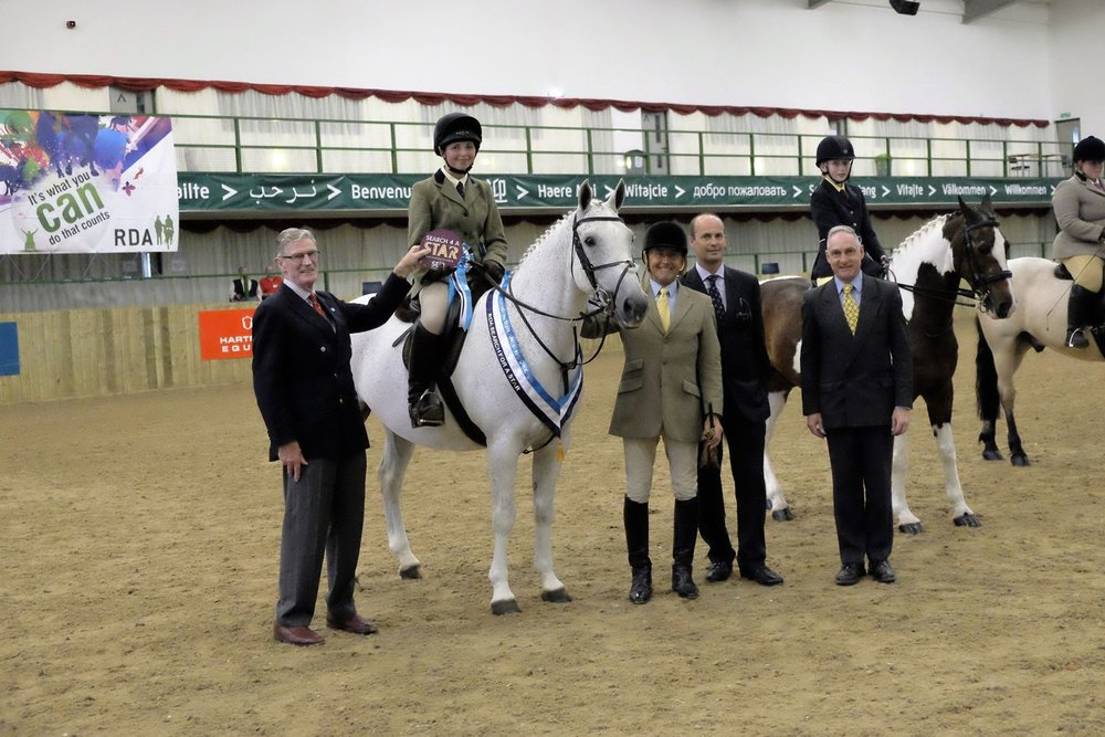 Rider Imogen Dark on Jimmy Jones, with Richard Ramsay, David Bartram-Lawton, David Ingle and Chris Bartram-Lawton after the 2016 SEIB RDA Showing class at Hartpury. Photo: Michael Martin