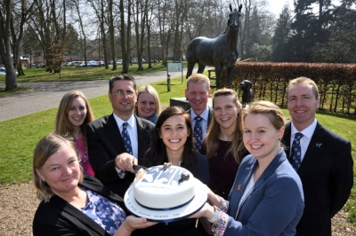 The team at The Animal Health Trust celebrate with a birthday cake