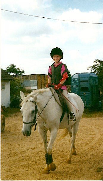 Me riding a horse called Gem at my local riding school, c.1998. We won a red rosette in the gymkhana!