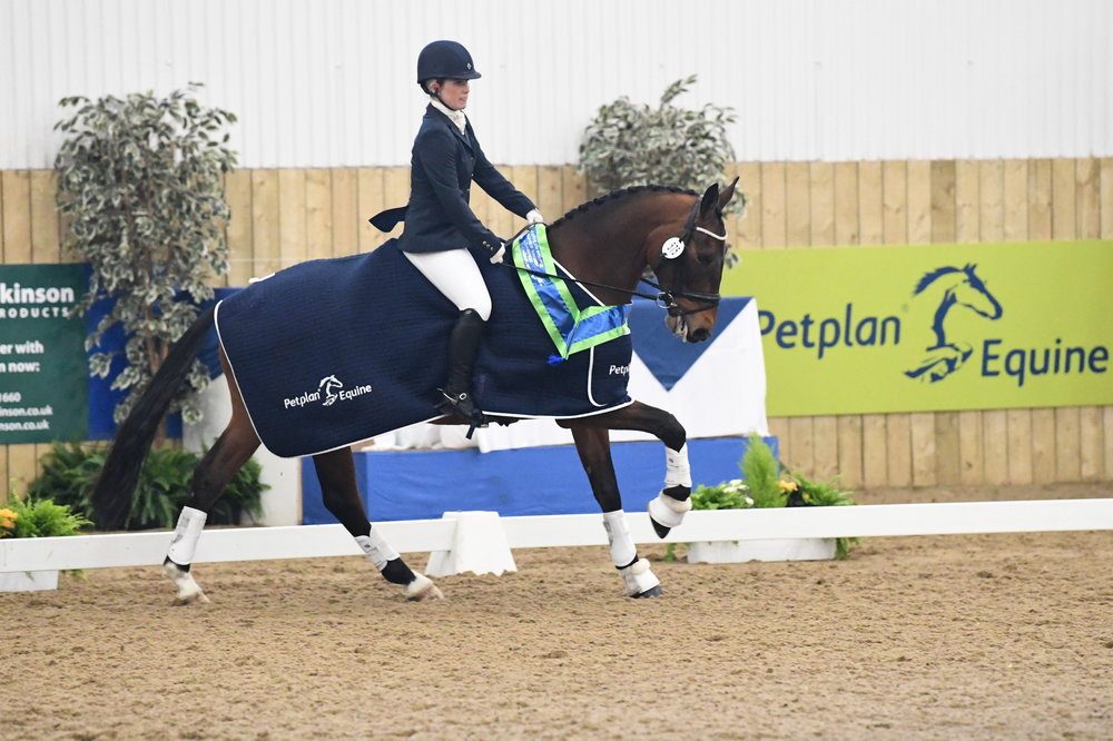 Novice Bronze winner Tayla Brooks from Lancashire at the annual Petplan Equine Area Festival Finals held at Hartpury College, Gloucestershire in April 2017.