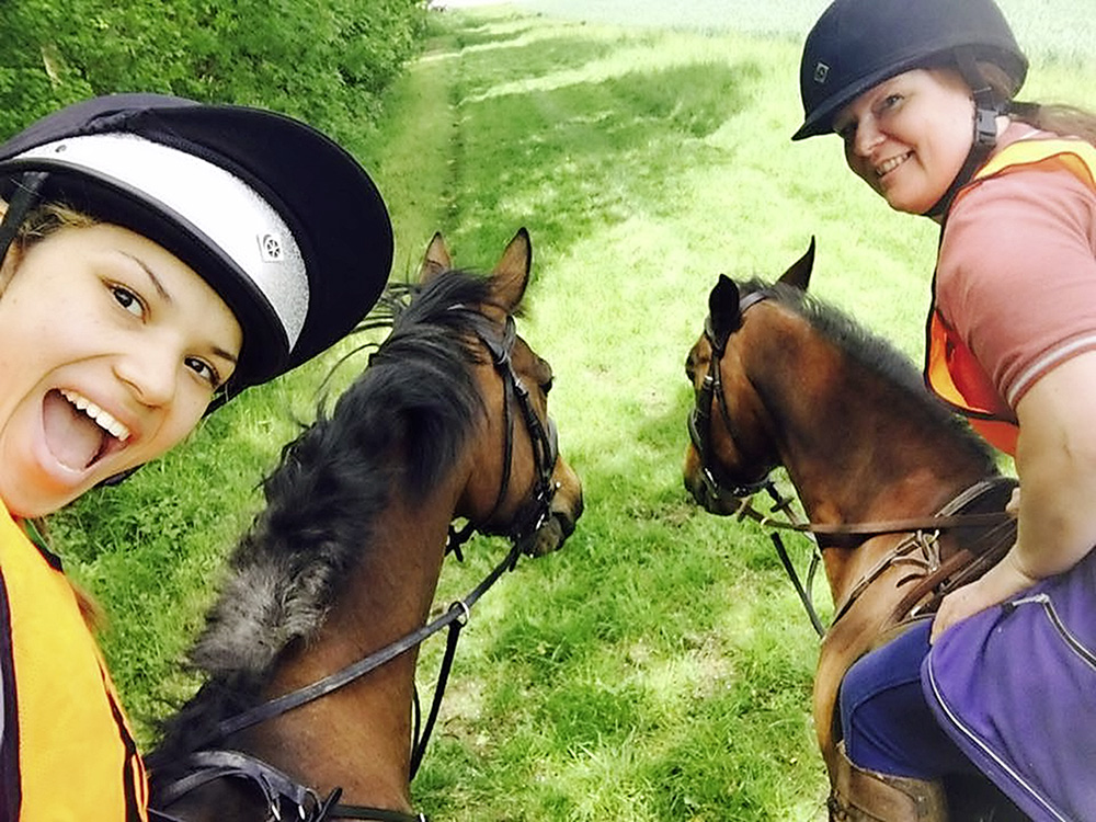 Louise riding Cally (right) and her daughter Sacha riding Kai on a recent fun ride
