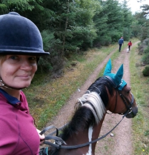 Lauren Maclean combines exercising her horse and dog at the same time