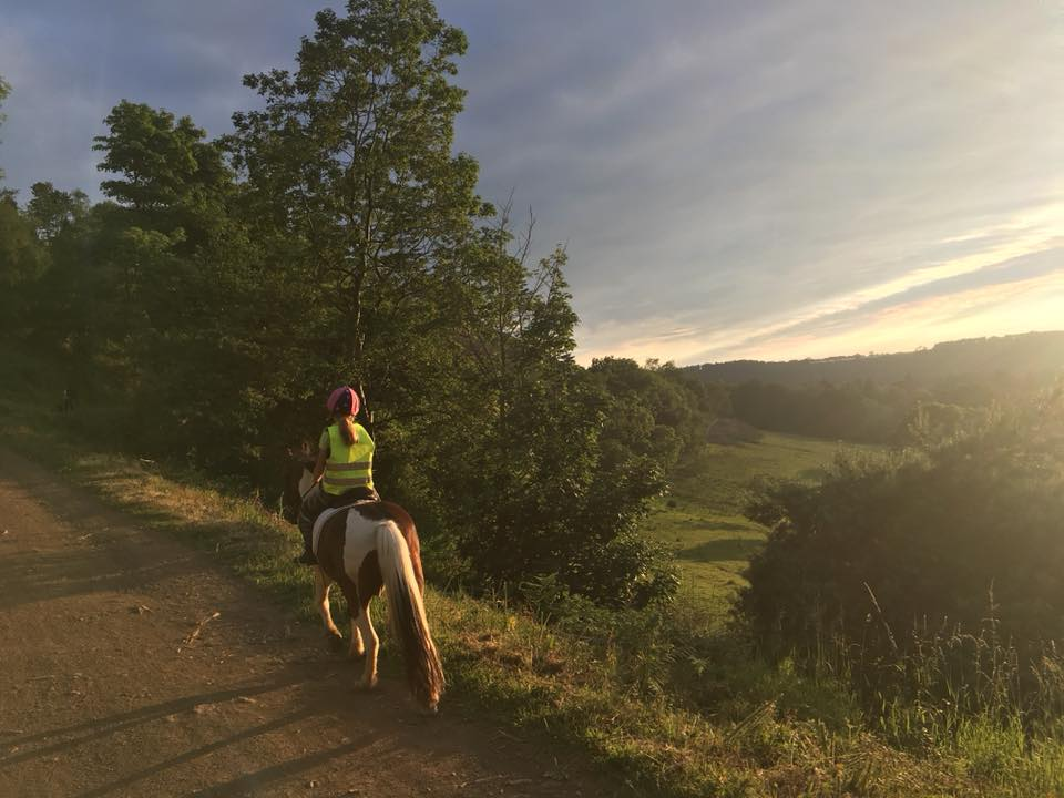 """Madelaine Burnett – """"Hacking is my absolute favourite thing to do. I get to enjoy the countryside and wildlife with my best friend and go as fast or slow as we want. I talk to her all the way and she loves it as much as I do."""""""