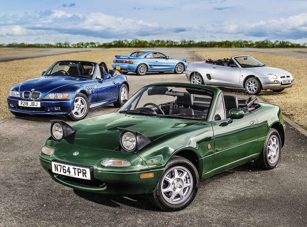When it comes to choosing a modern classic sports car, two is more than enough company. We've brought four of the era's two-seaters together to determine which makes the best practical classic today…