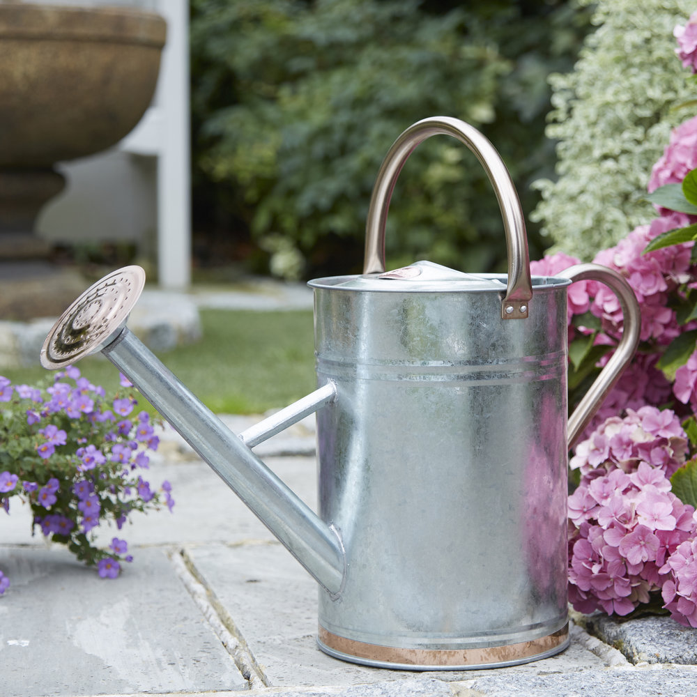 Metal watering can with copper trim