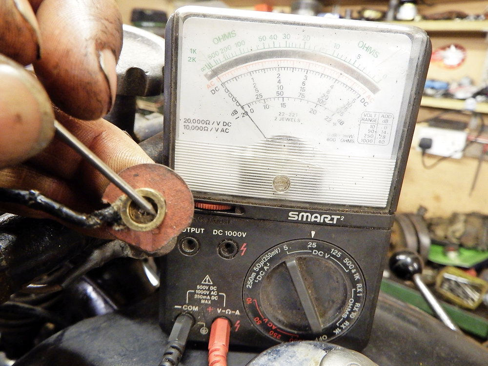 1.  Most horns work by earthing to the handlebar via the button, so the wire from horn to button should be live. Connecting a meter to the button wire, this one isn't.